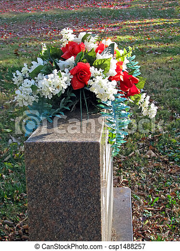Silk flowers on a cemetery grave headstone cemetery csp1488257 mightylinksfo