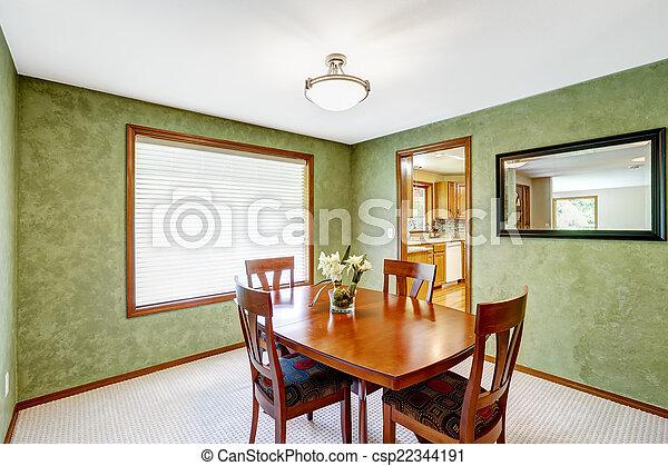 El comedor con paredes verdes brillantes - csp22344191