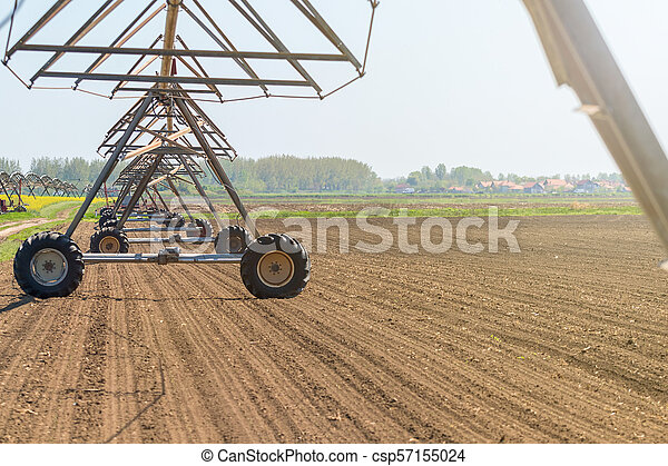 Center Pivot Irrigation System in field. Agriculture. - csp57155024