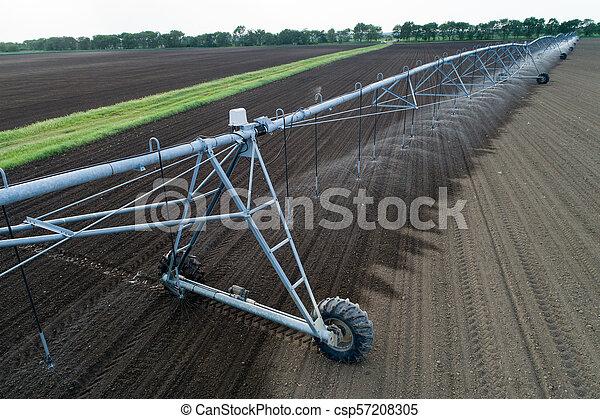 Center pivot irrigation system on field - csp57208305