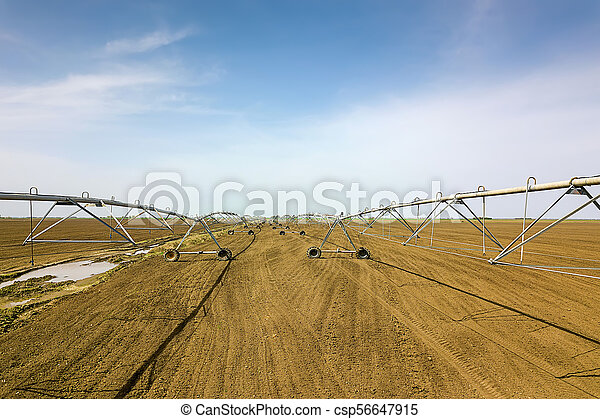 Center pivot irrigation system. Agricultural land, Aerial View. - csp56647915