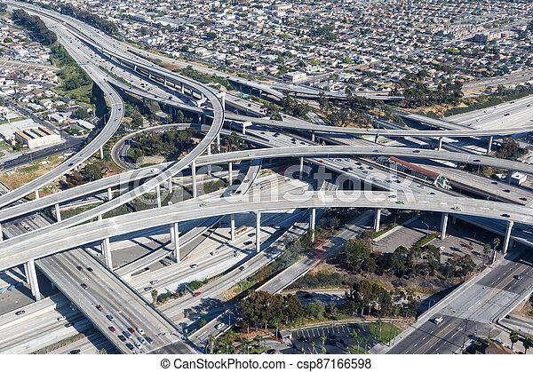 Century Harbor Freeway interchange intersection junction Highway Los Angeles roads traffic America city aerial view photo - csp87166598