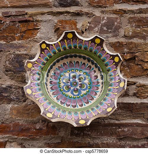 Ceramic bowl on stone wall - csp5778659