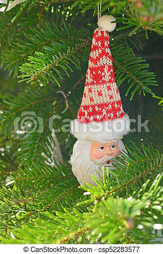 Ceramic Christmas toy Santa Claus on the Christmas tree - csp52283577