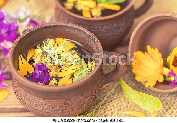 Ceramic cups of healthy herbal tea - csp48920195