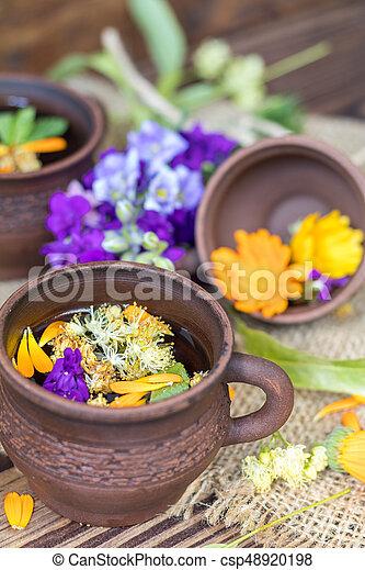 Ceramic cups of healthy herbal tea - csp48920198