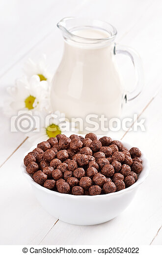 Cereal chocolate balls and jug of milk - csp20524022