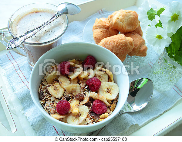 Cereals with berries and bananas for breakfast with cup of coffee - csp25537188