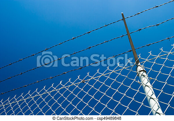 Chainlink fence and the blue sky - csp49489848