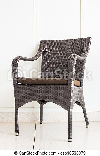 Chair furniture decoration on white wall - csp30536373