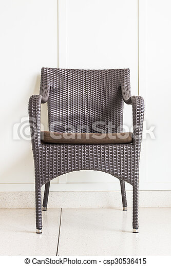 Chair furniture decoration on white wall - csp30536415