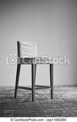 Chair on wall background - csp11683269