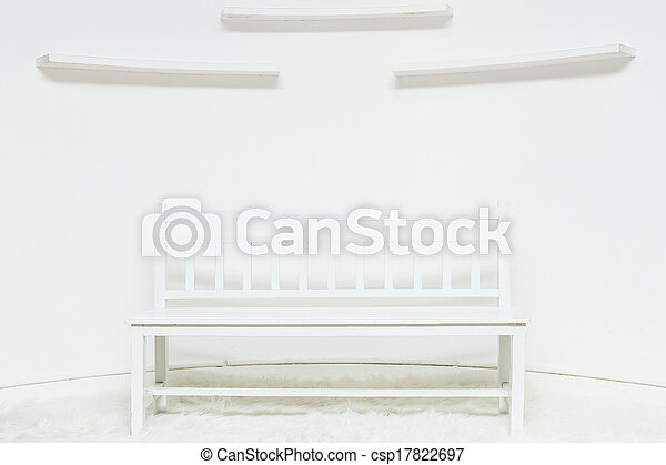 chair with white wall in background - csp17822697