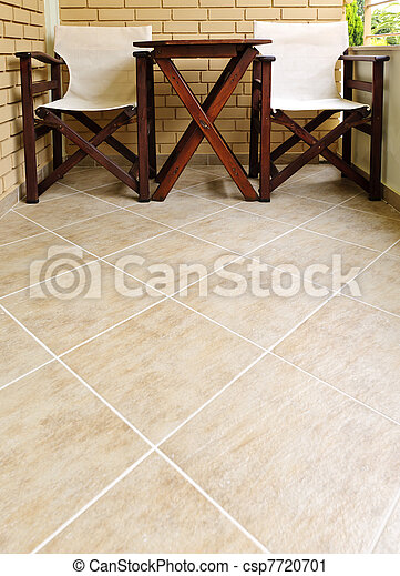 Chairs and table on tiled floor - csp7720701