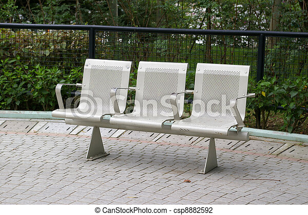 Chairs in a park - csp8882592