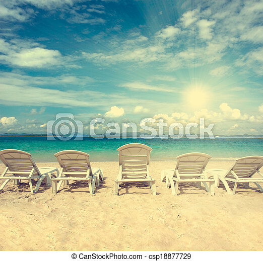 chairs on beach with blue sky for summer holiday vintage retro filter