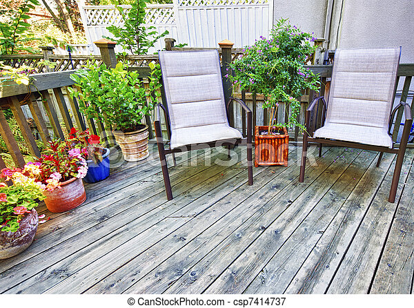 Chairs on wooden deck - csp7414737