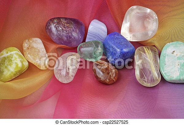 Chakra gemstones on Rainbow Chiffon - csp22527525