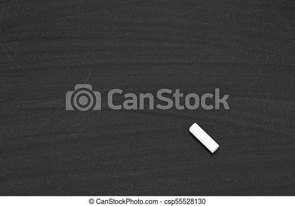 Chalk on a blackboard - csp55528130