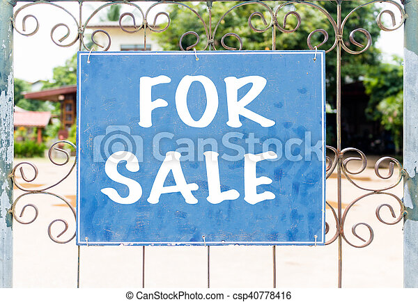 Chalkboard sign in front of house for sale - csp40778416