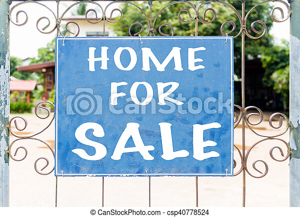Chalkboard sign in front of house for sale - csp40778524
