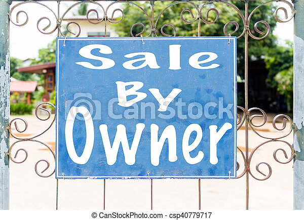 Chalkboard sign in front of house - csp40779717