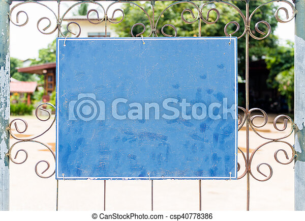 Chalkboard sign in front of house - csp40778386