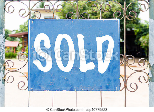 Chalkboard sign in front of house - csp40779523