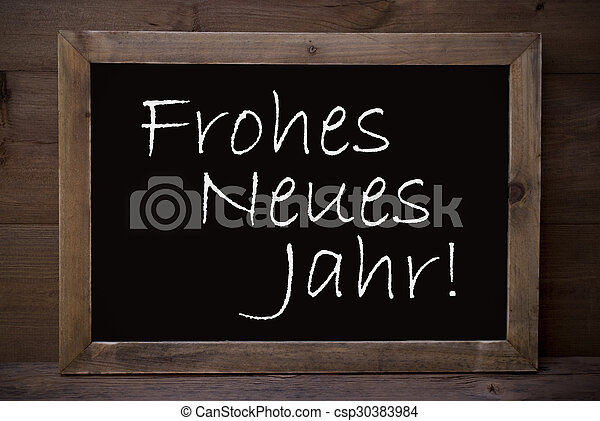 Chalkboard with frohes neues jahr means happy new year. Brown ...