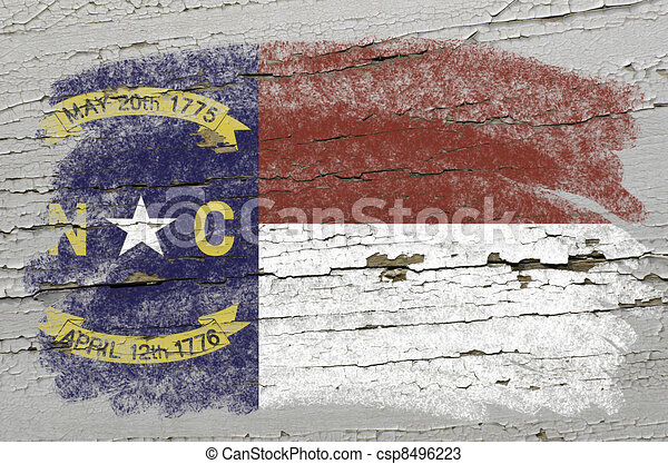 Chalky american state of north carolina flag precisely painted with color chalk on grunge wooden texture - csp8496223