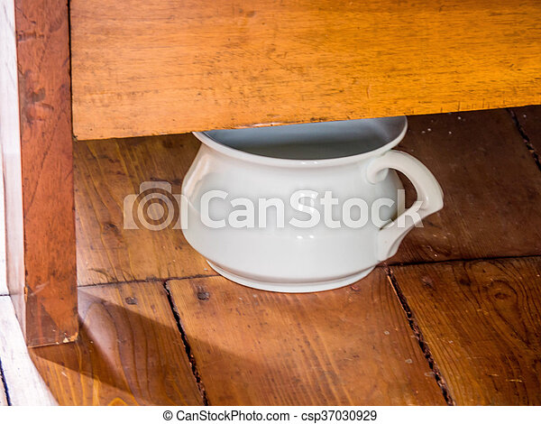 chamber pot under a bed - csp37030929