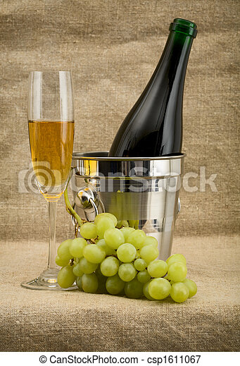 Champagne bottle, bucket, goblet and grapes - csp1611067