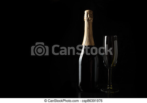 Champagne on a black background with space to copy. - csp86391976