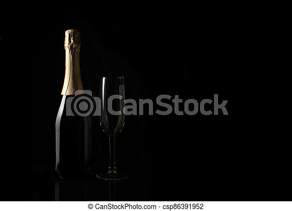 Champagne on a black background with space to copy. - csp86391952