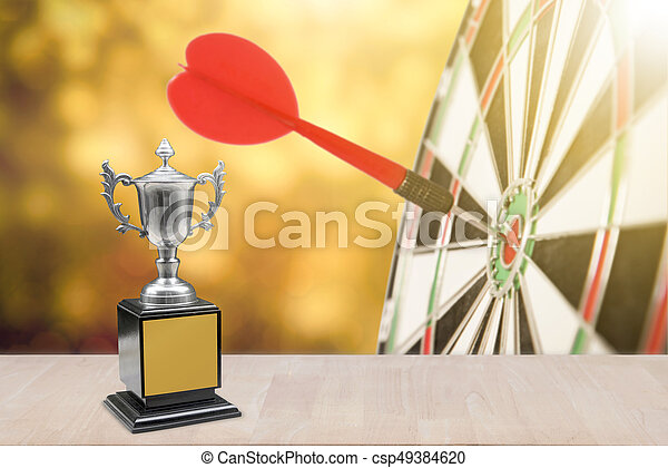 champion trophy placed on wooden table  copy space ready for your text