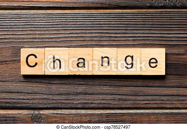 CHANGE word written on wood block. CHANGE text on wooden table for your desing, concept - csp78527497
