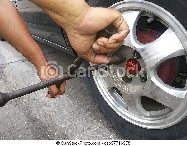 changing a tire on road - csp37716378