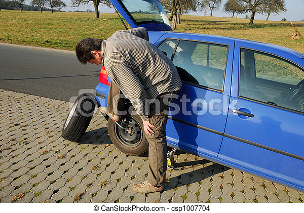 Changing a tire on the road - csp1007704