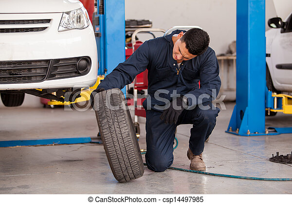 Changing tires at an auto shop - csp14497985