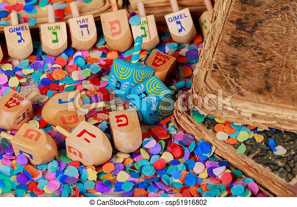Chanukah wooden dreidels on a wood surface. - csp51916802