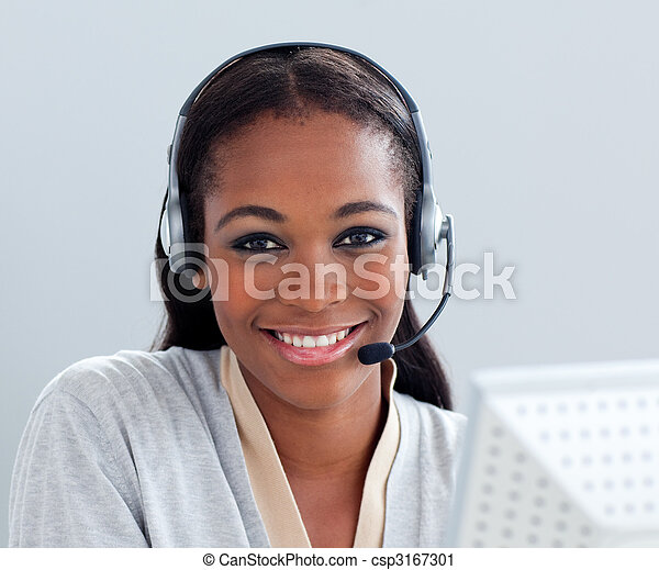 Charismatic businesswoman using headset at her desk - csp3167301