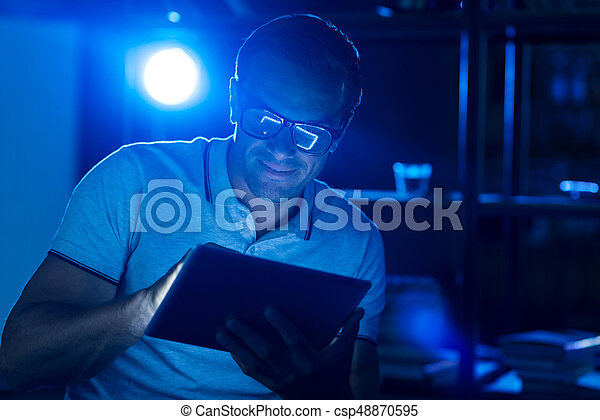 Charismatic motivated man working at night - csp48870595