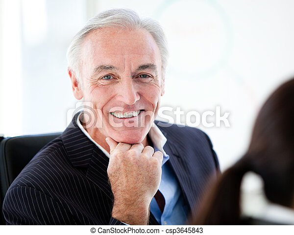 Charismatic senior businessman in a meeting - csp3645843