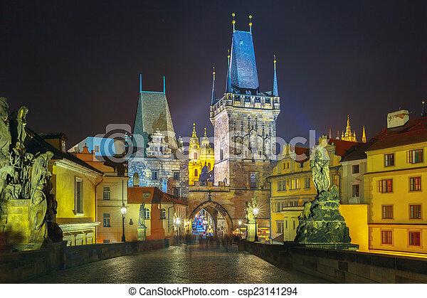 Charles Bridge in Prague (Czech Republic) at night lighting - csp23141294
