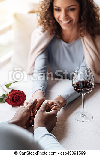 Charming African American woman holding hands with her boyfriend - csp43091599
