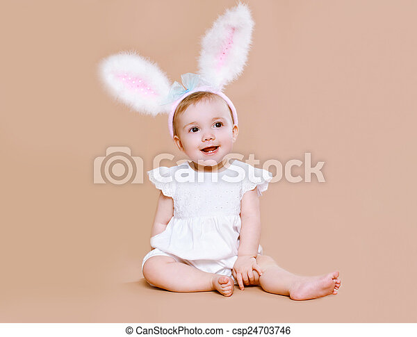 Charming baby sitting in costume easter bunny - csp24703746