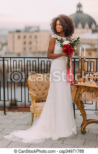charming black bride with wedding pictures csp34971788 - What is a Mail Order Bride?