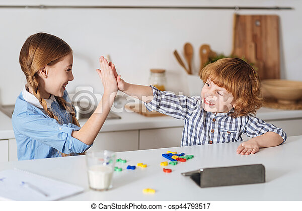 Charming brother and sister playing together - csp44793517