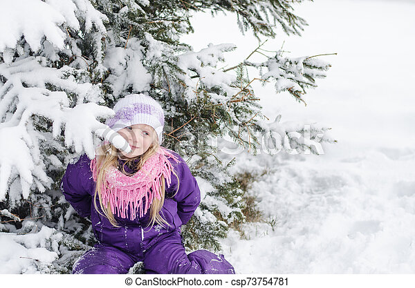 charming child in winter nature - csp73754781