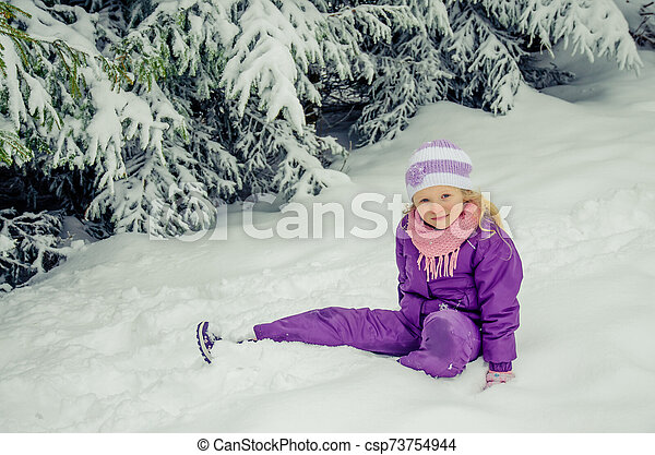 charming child in winter nature - csp73754944